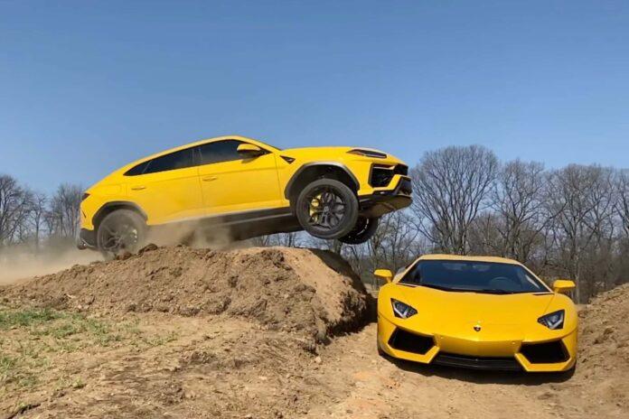 Lamborghini jumping over another Lamborghini on a dirt track